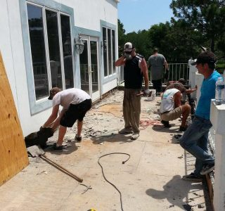 Workers on job site repairing plywood decking