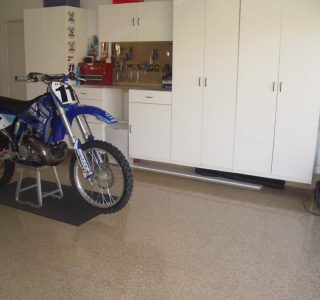 Epoxy Flooring in family garage with a motorcycle
